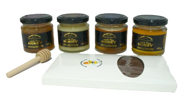 A sample of each honey plus a dipper and a bar of luxurious heather honey chocolate